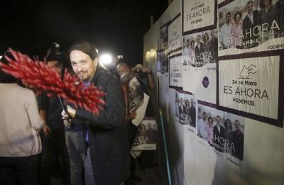 En campaña para las municipales , en las que Podemos no va con listas propias
