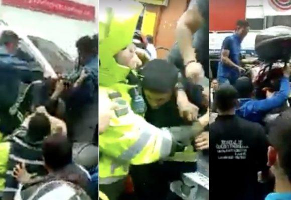 A pata cogieron a policías y chofer de grúa (armado) por una multa: !Qué país!