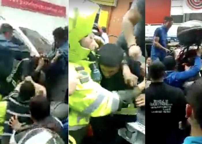 Video: A golpes cogieron a policías y chofer de grúa (armado) por una multa