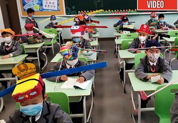 Niños chinos, como robotcitos regresan al colegio