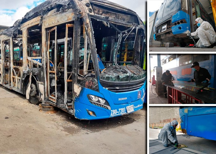 Los mecánicos que recuperan en tiempo recordlos buses vandalizados de Transmilenio